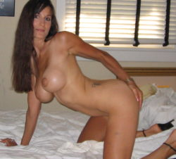 Hot milf naked on her bed