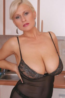 Milf with short blonde hair and massive mams