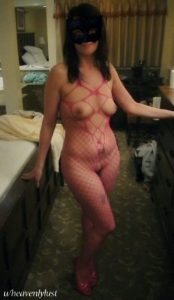 My exquisitely beautiful 40yo slutty wife flashing a cute smile in a crotchless pink fishnet bodystocking and pumps.