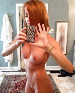 Older shaved redhead with unbelievably tight body
