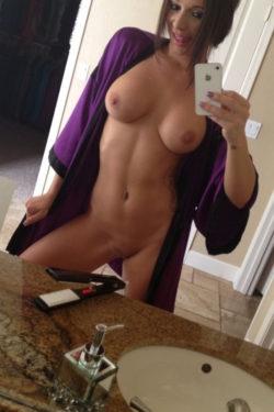 Open bathrobe selfie