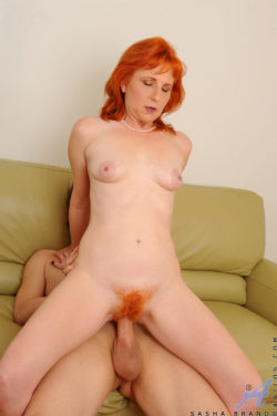 Redhead milf with fiery muff in action