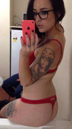 Serious tats and a red thong