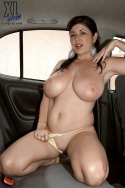 Shaved brunette milf with huuuge tits