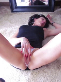 Touching her pussy in crotchless panties.