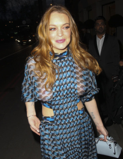 What's left of Lindsay Lohan wearing a dress that exposes her tits