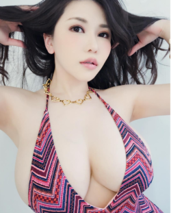 Anri Okita showing off her cleavage