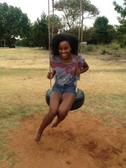 Beautiful ebony on a swing
