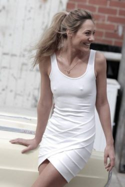 Braless in a white dress