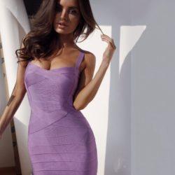 Brunette in a purple bandage dress