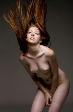 Ginger hair flip.