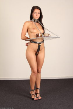 Melissa in a chastity belt and steel cuffs with coffee! (AIC)