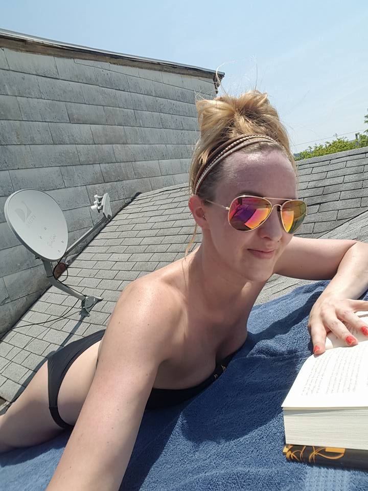 Sexy blonde catching some rays on the roof..