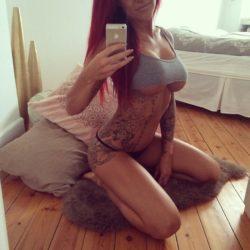 Tattooed under boob beauty