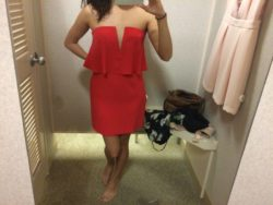 Trying on a red dress