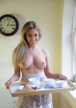 Cute blonde serving afternoon tea topless