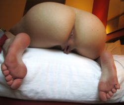 On the edge of the bed