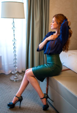 Tight green leather skirt