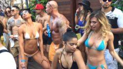 Can anyone identify the girl in the sunglasses and white bikini?
