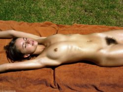 Girl with bush on towel