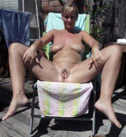 MILF tanning outside
