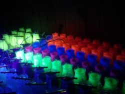 Mostly completed UV candles under indirect black light.