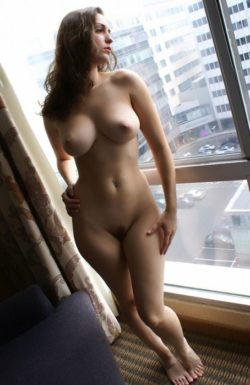 Naked by the window