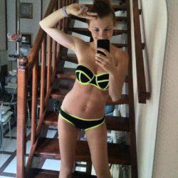 Tanned beauty in swimsuit