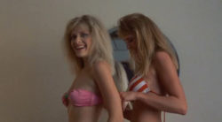 Barbara Crampton & Kathleen Kinmont showing their plots in Fraternity Vacation (1985)