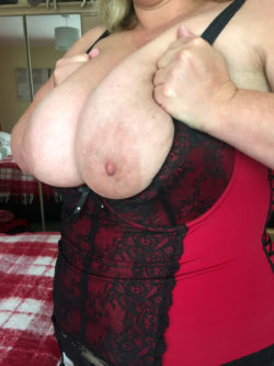 My wife's huge tits.