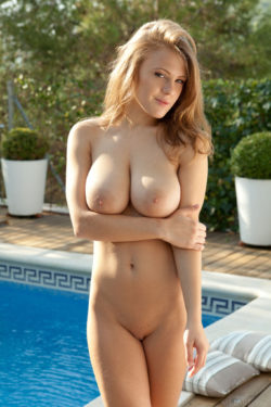 Naked by the swimming pool