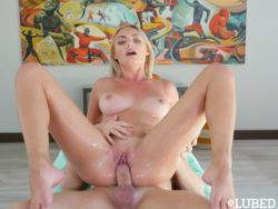 Oiled up blondie rides hard cock