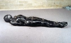 Rubber body bag and leather straps lead to a fun play time!