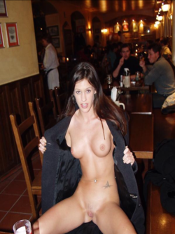 Showing off her tattoo for free drinks. [IMG]