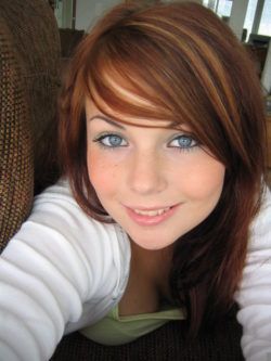 Smiling redhead with grey eyes