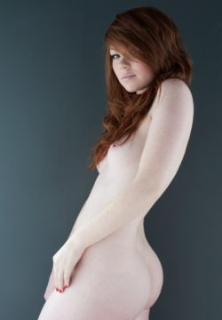 Soft pale skin and red foxy hair