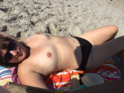 Wife topless on the beach
