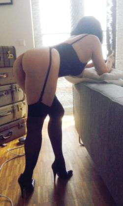 milf in black lingerie showing off