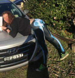posing on new car