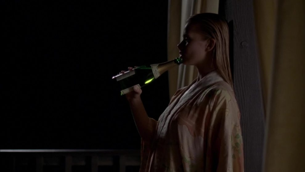 """Jaime Pressly playing with champagne in """"Poison Ivy: the new seduction"""" (1997)"""