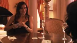 Sandrine Holt losing at strip poker
