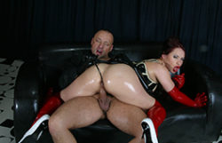 Large latex ass receives it rock hard