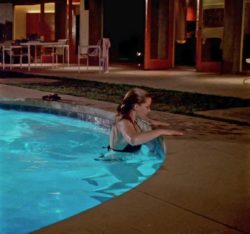 19 year old Amber Heard getting out of a pool on Criminal Minds