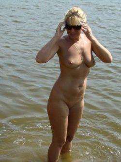 Sexy blonde Milf bare about beach