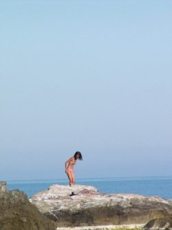 Cute teenager nude at the bare beach