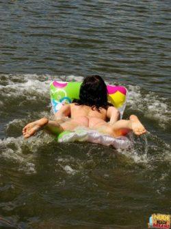 A couple having exterior nude fun