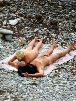 Nudists couple at the beach