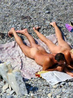 Blonde MILF caught sucking penis at the beach