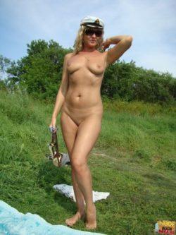 Nude beach babe flaunts her stuff