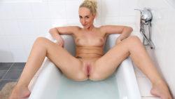 Golden-haired mom disrobes bare